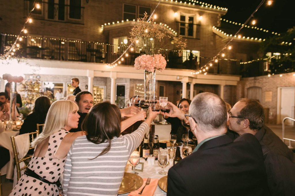 Molly-and-Joes-wedding-guest-toasting-at-table