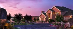Front View of Mansion with Purple Dusk Sky